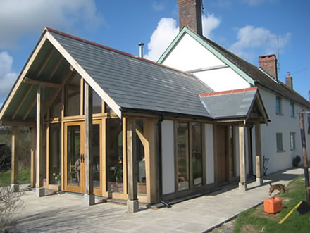 Traditional oak timber frame manufacture devon for Oak framed house designs